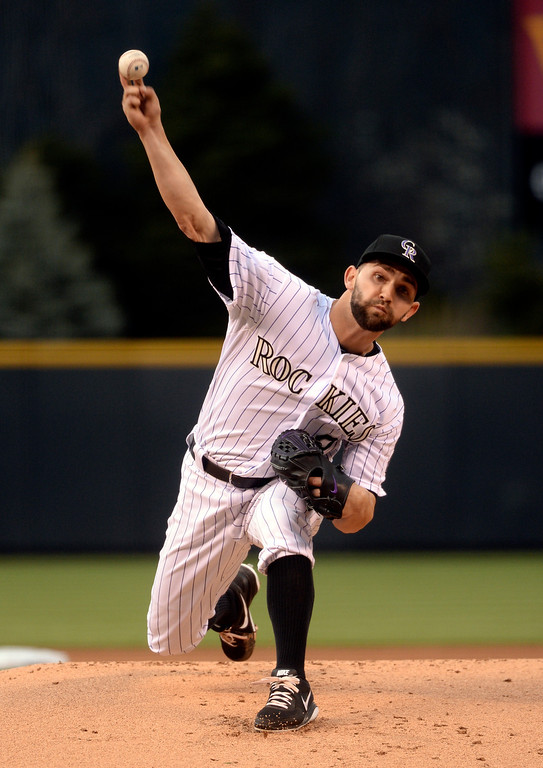 . DENVER, CO - APRIL 18: Colorado starting pitcher Tyler Chatwood delivered to the plate in the first inning. The Colorado Rockies hosted the Philadelphia Phillies Friday night, April 18, 2014 at Coors Field.  (Photo by Karl Gehring/The Denver Post)