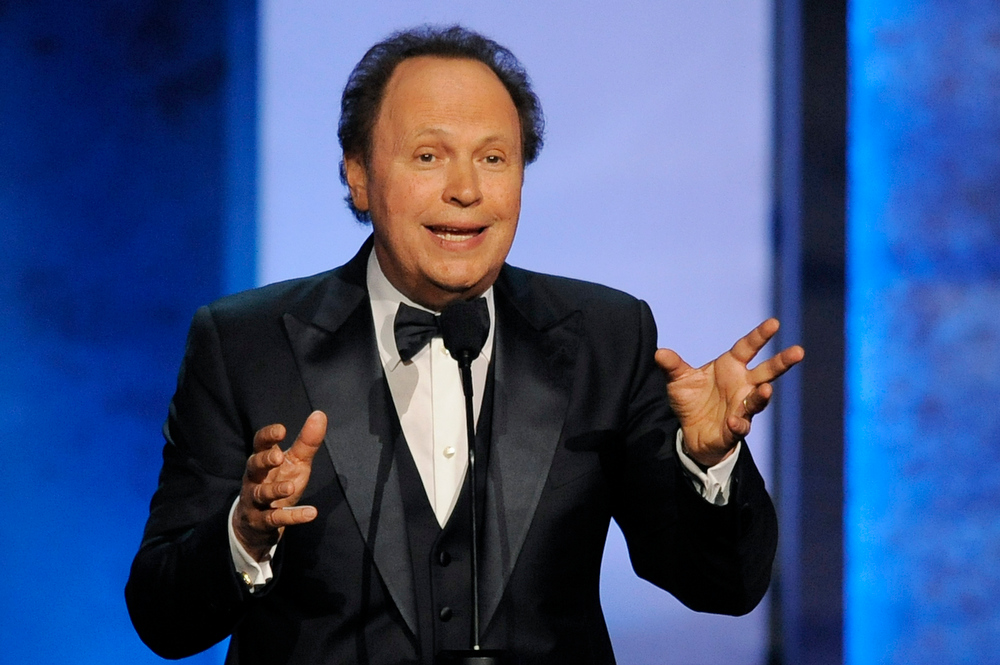 . Billy Crystal addresses the audience during the American Film Institute\'s 41st Lifetime Achievement Award Gala honoring Mel Brooks at the Dolby Theatre on Thursday, June 6, 2013 in Los Angeles. (Photo by Chris Pizello/Invision/AP)