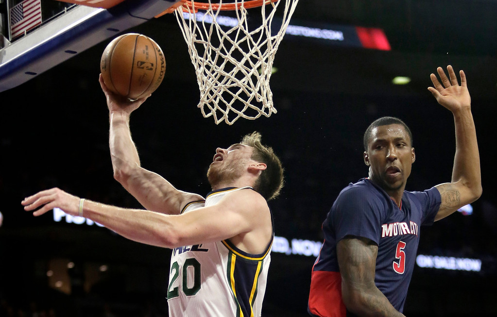 . Utah Jazz\'s Gordon Hayward (20) goes to the basket past Detroit Pistons\' Kentavious Caldwell-Pope (5) during the first half of an NBA basketball game Sunday, Nov. 9, 2014, in Auburn Hills, Mich. Hayward led the Jazz with 17 points in a 97-96 win. (AP Photo/Duane Burleson)