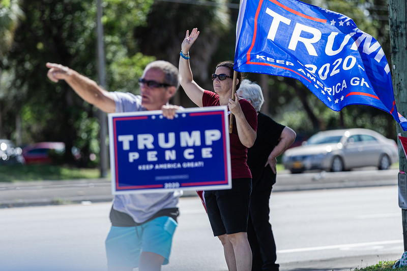 Supporters of President Donald J. Trump wave flags and cheer on the corner of Hypoluxo and Jog in Lake Worth on Election Day, Tuesday, November 3, 2020. (JOSEPH FORZANO / THE PALM BEACH POST)