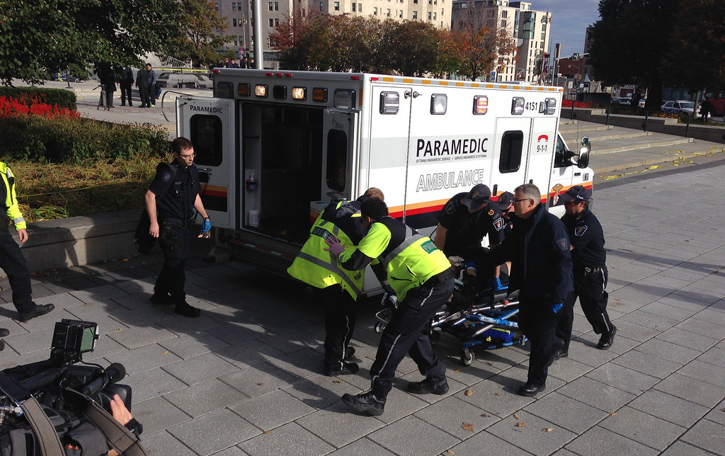 . Police and paramedics transport a wounded Canadian soldier on October 22, 2014 in Ottawa, Ontario. Canadian police backed by armored vehicles surrounded parliament in Ottawa on Wednesday after a soldier was shot while guarding a nearby monument. Witnesses said they saw a gunman running to the parliament building after the shooting. Heavily armed police raced to seal off the building and the office of Canadian Prime Minister Stephen Harper. AFP PHOTO/MICHEL COMTEMICHEL COMTE/AFP/Getty Images