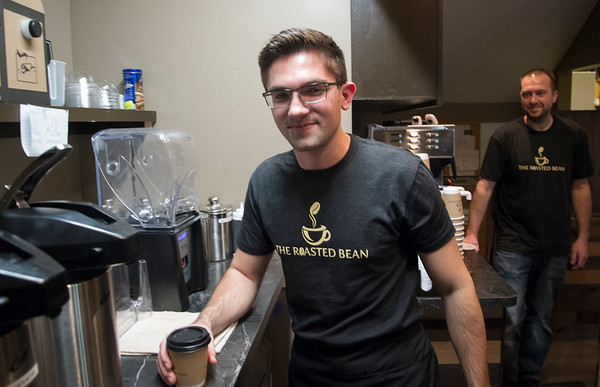 01/27/20 Wesley Bunnell | StaffrrEmployee Nathan Virovoy prepares a coffee as co-owner Doug Lamonthe looks on at the Roasted Bean coffee shop. The shop which opened approximately two weeks ago is located at 934 Terryville Ave in Bristol.
