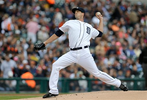 . Detroit Tigers pitcher Drew Smyly throws a warmup pitch against the Minnesota Twins pitcher Kyle Gibson throws a warmup pitch against the Detroit Tigers in the first inning of a baseball game in Detroit, Friday, June 13, 2014.  (AP Photo/Paul Sancya)