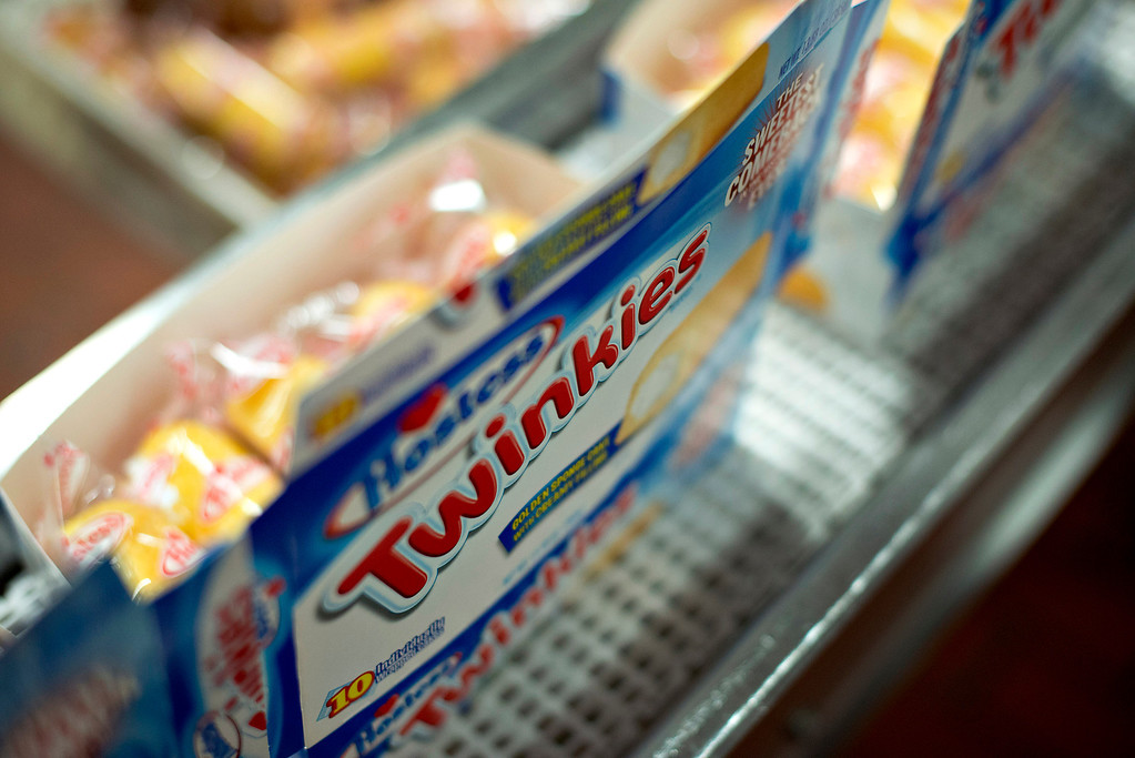 . Boxes of Hostess Brands LLC Twinkies snack cakes sit on the packaging line at a Hostess bakery in Schiller Park, Illinois, U.S., on Monday, July 15, 2013. Photographer: Daniel Acker/Bloomberg