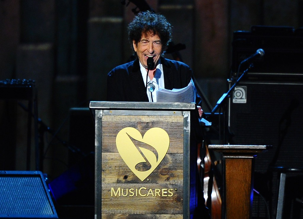 . Bob Dylan accepts the 2015 MusiCares Person of the Year award on stage at the 2015 MusiCares Person of the Year show at the Los Angeles Convention Center on Friday, Feb. 6, 2015, in Los Angeles. (Photo by Vince Bucci/Invision/AP)