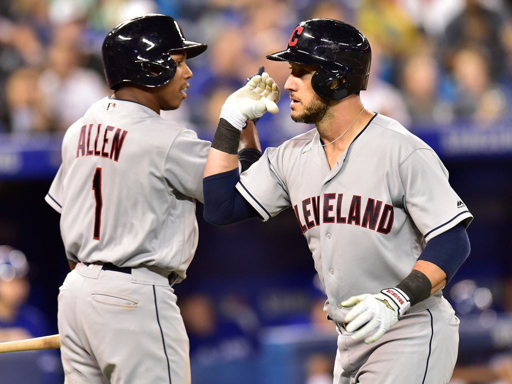 . Cleveland Indians\' Yan Gomes celebrates his home run with Greg Allen (1) against the Toronto Blue Jays during the sixth inning of a baseball game Friday, Sept. 7, 2018, in Toronto. (Frank Gunn/The Canadian Press via AP)