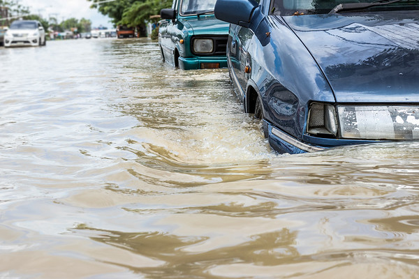 Car,Driving,On,A,Flooded,Road,,The,Broken,Car,Is