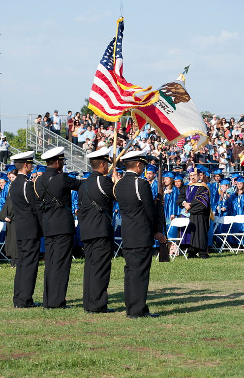 . Reseda High School ROTC Color Guard stands at attention during the Pledge of Allegiance and National Anthem. The Reseda High School graduation class held their commencement in the school football field on Friday,  June 07, 2013 in Reseda, CA.   Photo by Carlos Carpio