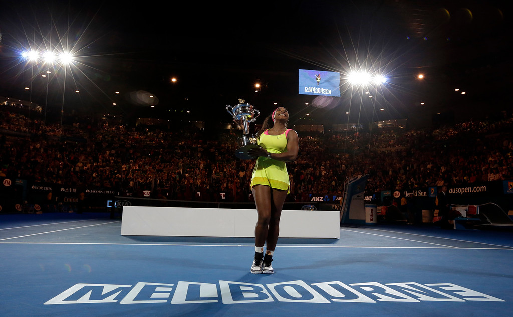 . Serena Williams of the U.S. holds the trophy after defeating Maria Sharapova of Russia in the women\'s singles final at the Australian Open tennis championship in Melbourne, Australia, Saturday, Jan. 31, 2015. (AP Photo/Bernat Armangue)