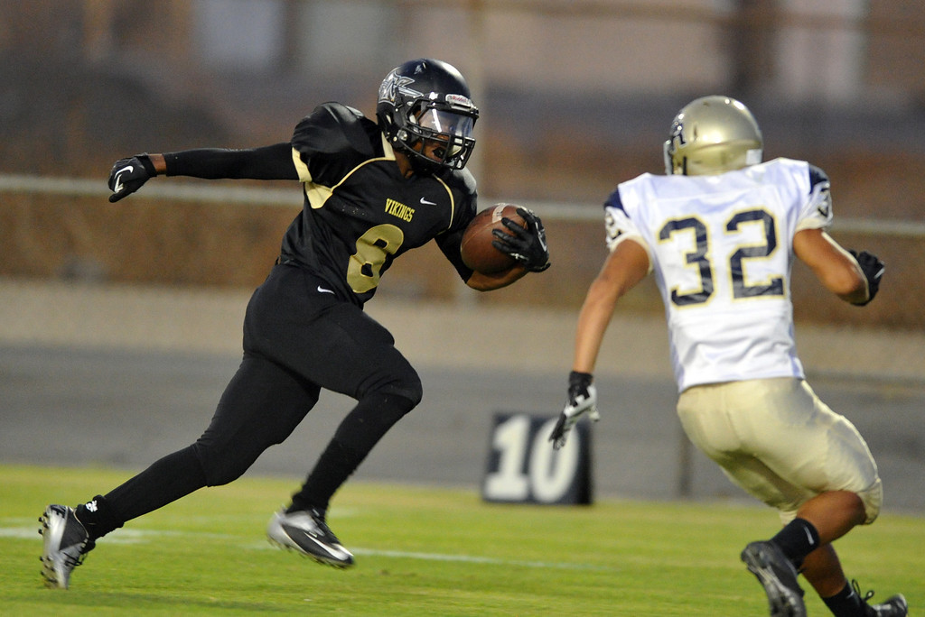 . Northview runningback Christeon Blackmon (#8)  carries the ball just short of a touchdown in the first quarter as they play Rowland in their non-league game at Covina District Field in Covina on Friday September 13, 2013.  (San Gabriel Valley Tribune/Staff Photo by Keith Durflinger)