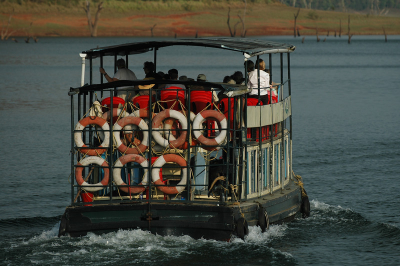 A tourist boat traveling on the lake in the Periyar Wildlife Preserve
