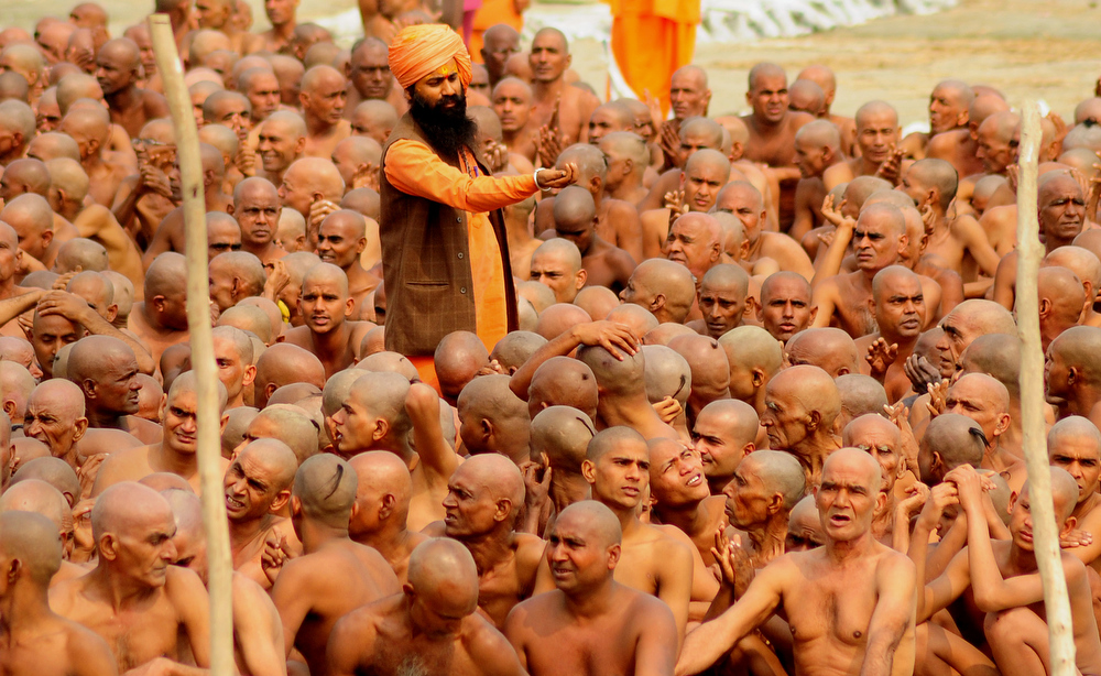 Description of . Newly initiated 'naga sadhus' perform rituals on the bank of the Ganga River during the Maha Kumbh festival in Allahabad on Febraury 6, 2013.   During every Kumbh Mela, the diksha - ritual of initiation by a guru - program for new members takes place. Sanjay Kanojia/AFP/Getty Images