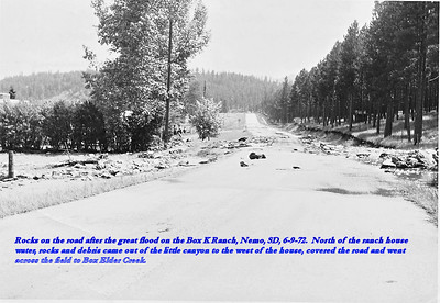 Rocks on the road after the great flood on the Box K Ranch, Nemo, SD, 6/9/72.  North of the ranch house water, rocks and debris came out of the little canyon to the west of the house, covered the road and went across the field to Box Elder Creek.