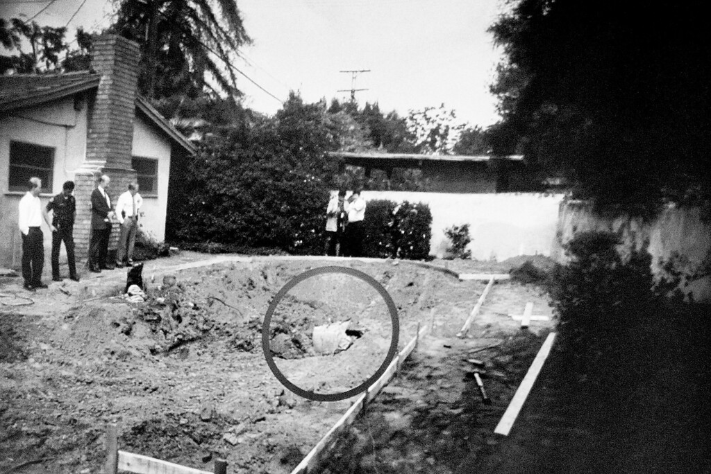 ". A projected photo on the screen to the jurors, showing where a container was found with the body of John Sohus, when a pool was being dug at the home on Lorraine Road in 1985 in San Marino.The murder trial of Christian Gerhartsreiter, 52,  known as ""Clark\"" Rockefeller, begins at Clara Shortridge Fortz Criminal Justice Center in Los Angeles on Monday, March 18, 2013.  Gerhartsreiter is a German immigrant who masqueraded as a member of the Rockefeller family. He is charged with murder of John Sohus, 27, whose bones were unearthed from the backyard of the home in San Marino, California, in 1985.  Sohus\' wife, Linda, has never been found."