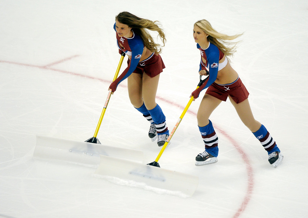 . The Avalanche Ice Girls scraped the playing surface during a time out.  Photo By Karl Gehring/The Denver Post