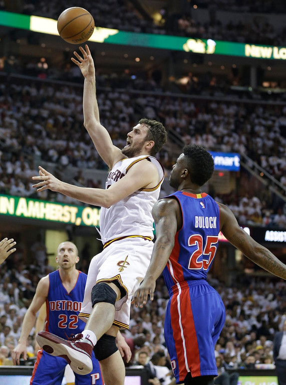 . Cleveland Cavaliers\' Kevin Love (0) shoots against Detroit Pistons\' Reggie Bullock (25) in the first half in Game 1 of a first-round NBA basketball playoff series, Sunday, April 17, 2016, in Cleveland. (AP Photo/Tony Dejak)