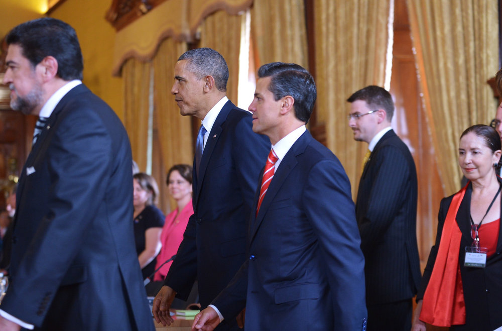 . US President Barack Obama (2-L) and Mexican President Enrique Pena Nieto (3-L) make their way to their seats for a bilateral meeting on May 2, 2013 at the Palacio Nacional in Mexico City.  Obama landed in Mexico on Thursday at the start of a three-day trip that will also take him to Costa Rica, with trade, US immigration reform and the drug war high on the agenda. The runways of Mexico City\'s international airport closed for half an hour to let Air Force One land, and Obama was scheduled to head to the historic National Palace downtown for talks with Mexican President Enrique Pena Nieto.   MANDEL NGAN/AFP/Getty Images