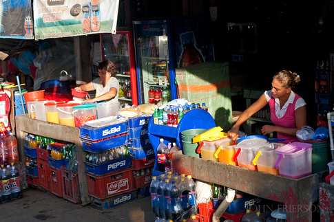 Vendors preparing agua fresca (fruit flavored sugar water) drinks to sell.