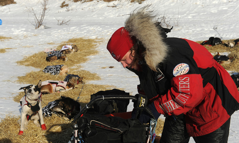 . Iditarod musher Aliy Zirkle, from Two Rivers, Alaska, works on her gear at the White Mountain checkpoint during the 2014 Iditarod Trail Sled Dog Race on Monday, March 10, 2014. Zirkle has her out time for the checkpoint written on her finger. (AP Photo/The Anchorage Daily News, Bob Hallinen)