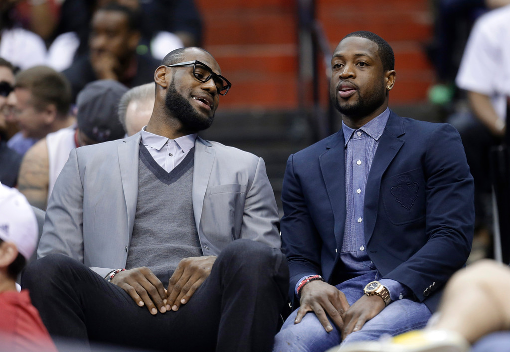 . Miami Heat\'s LeBron James, left, and Dwyane Wade sit on the bench during the first half of an NBA basketball game against the Washington Wizards on Wednesday, April 10, 2013, in Washington. (AP Photo/Evan Vucci)