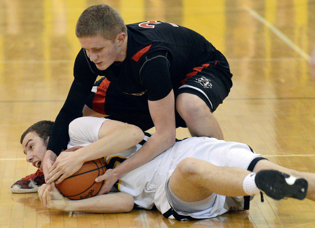 . Duncan Scott/DScott@News-Herald.com Riverside\'s Ronnie Krsolovic and Chardon\'s Jason Janda wrestle for a loose ball in the fourth quarter. Riverside won Friday\'s PAC matchup 49-43 at the Riverside Community Field House.