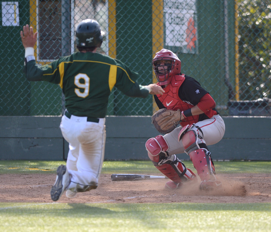 . Westchester catcher makes an easy tag of Mira Costa #9 Mateo Nieto. Mira Costa defeated Westchester 2-1 at home in boy\'s baseball.  Photo by Brad Graverson 3-26-13