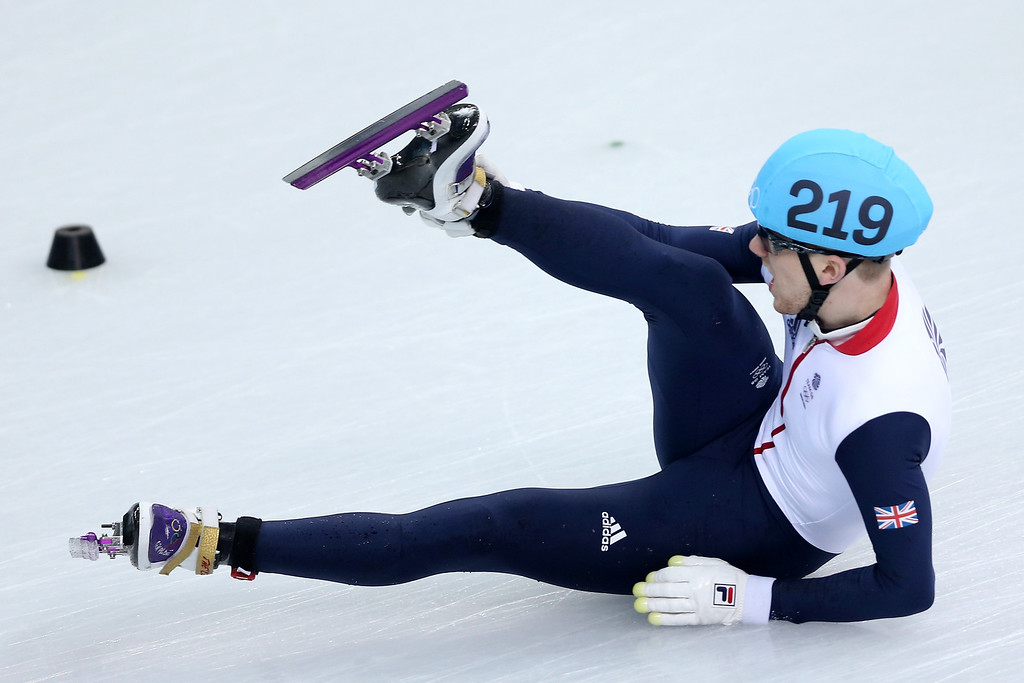 . Jack Whelbourne of Great Britain falls while competing in the Short Track Men\'s 1500m Final on day 3 of the Sochi 2014 Winter Olympics at Iceberg Skating Palace on February 10, 2014 in Sochi, Russia.  (Photo by Matthew Stockman/Getty Images)