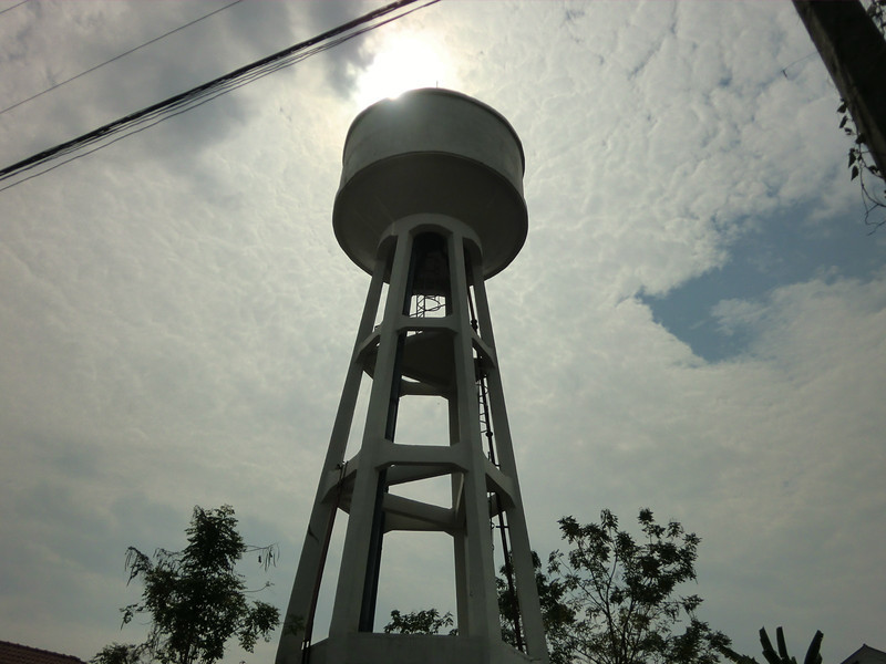Water tower and sun