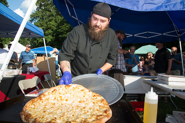 08/08/19 Wesley Bunnell | Staff Mike Truss, owner and chef of Craft Kitchen prepares to serve mac n cheese pizza at the Taste of Southington on Thursday August 8, 2019 at the Barnes Museum.
