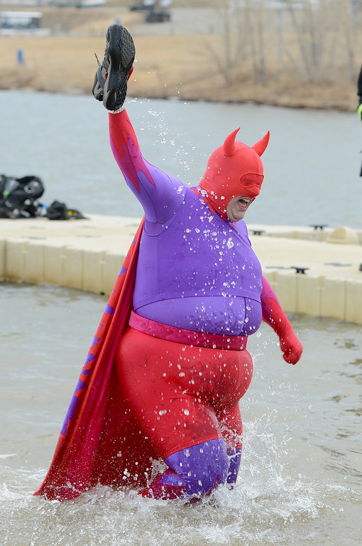 """. James \""""Boo Boo\"""" Wild, does what a super hero does, rescues a shoe, from the cold water. The 31st annual Boulder Polar Plunge, at the Boulder Reservoir on New Year�s Day, to help the Boulder County AIDS Project and connectBCAP.  Cliff Grassmick/Daily Camera"""