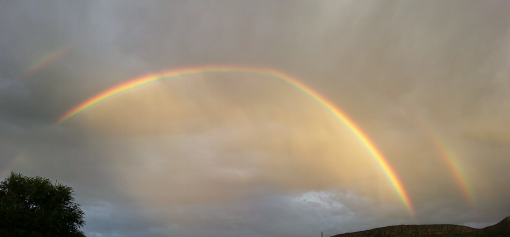 . After days of torrential rain, it was heartening to see this double rainbow in Golden, Colorado on Friday evening, spanning from S. Table Mountain to N. Table Mountain. Photo by Margaret Auld-Louie