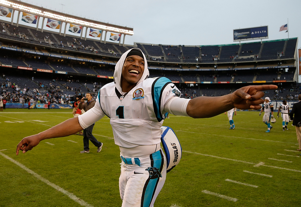 Description of . Carolina Panthers quarterback Cam Newton gestures after beating the San Diego Chargers in an NFL football game Sunday, Dec. 16, 2012, in San Diego. The Panthers won, 31-7. (AP Photo/Gregory Bull)
