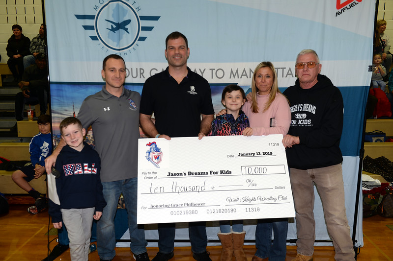 Wrestling Fundraiser held at Wall Township High School with Nolan and Michael Parnell, Rob Philhower, Honoree Grace Philhower, Jackie Philhower, and Dennis McGinnis of Jason's Dreams For Kids on 01/13/2019.