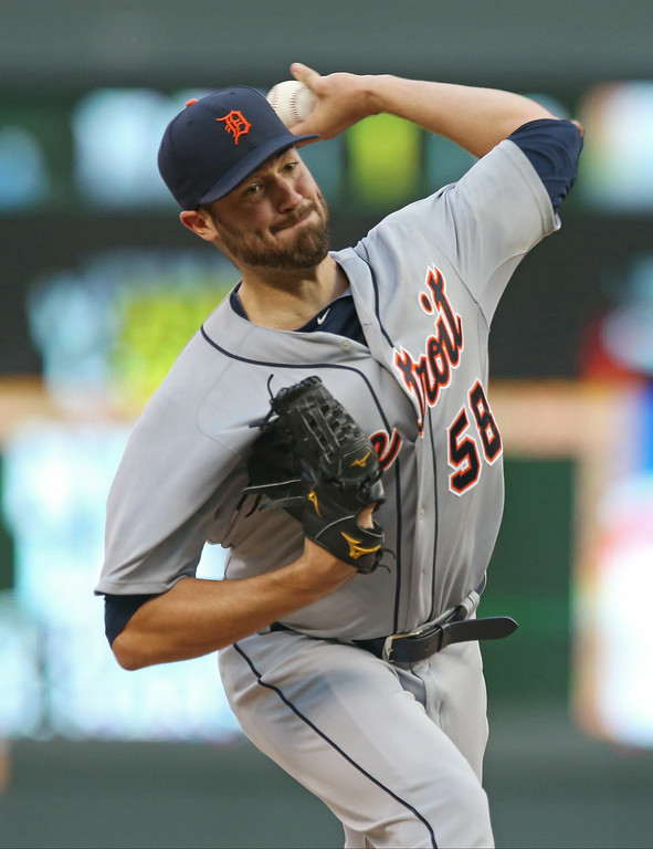 . Detroit Tigers starting pitcher Robbie Ray throws against the Minnesota Twins in the first inning of a baseball game, Friday, Aug. 22, 2014, in Minneapolis. (AP Photo/Jim Mone)