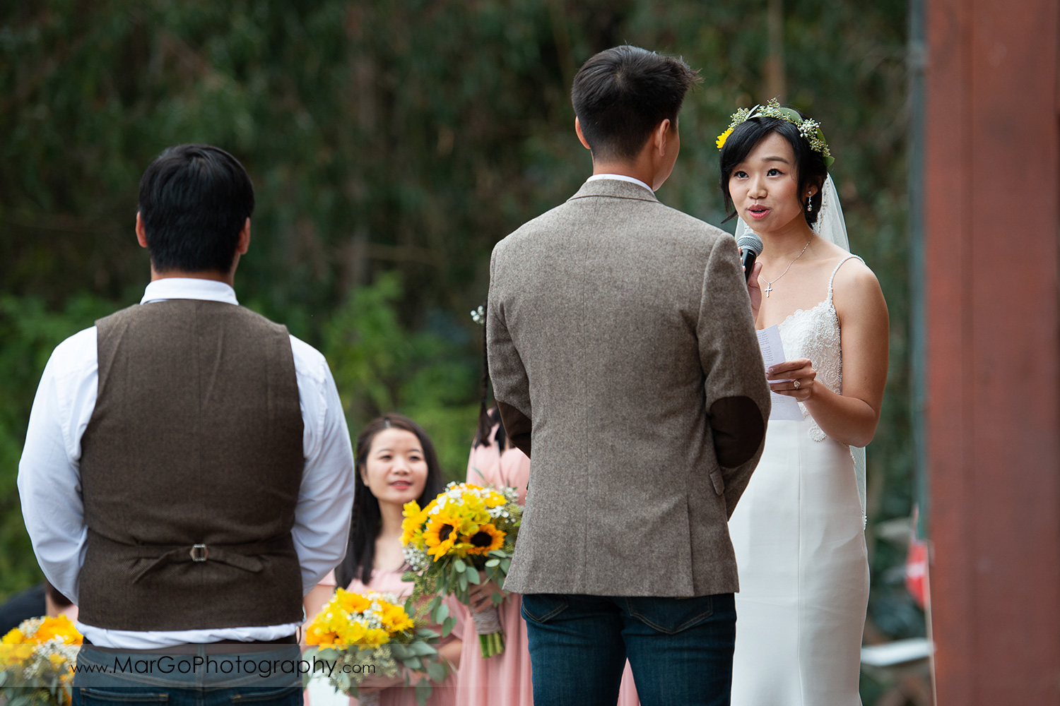 bride reading vows during wedding ceremony at Long Branch Saloon & Farms in Half Moon Bay