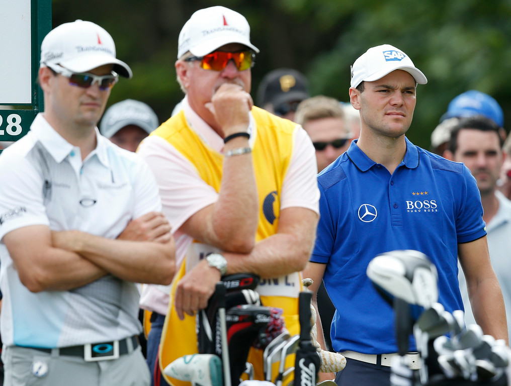 . Martin Kaymer of Germany, right, waits to play on the 5th tee box with Zach Johnson of the US and his caddie Damon Green during the second day of the British Open Golf championship at the Royal Liverpool golf club, Hoylake, England, Friday July 18, 2014. (AP Photo/Alastair Grant)
