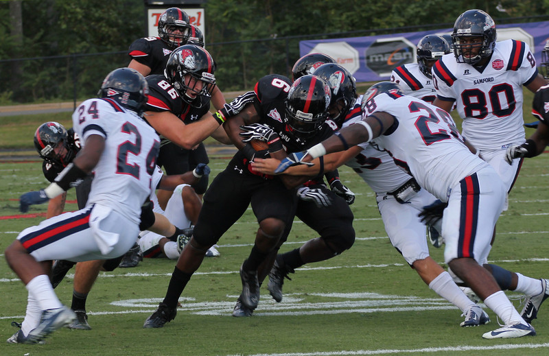 Gardner-Webb's running back, Kenny Little, powers through the Samford defense.