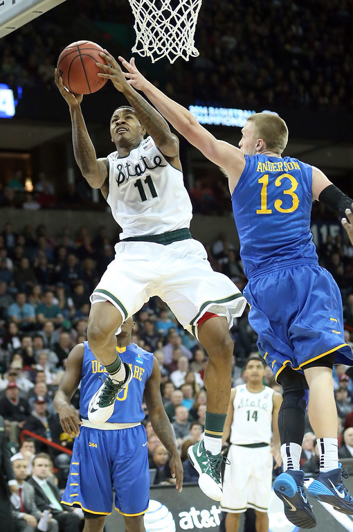 . Keith Appling #11 of the Michigan State Spartans shoots over Kyle Anderson #13 of the Delaware Fightin Blue Hens during the second round of the 2014 NCAA Men\'s Basketball Tournament at Spokane Veterans Memorial Arena on March 20, 2014 in Spokane, Washington.  (Photo by Stephen Dunn/Getty Images)