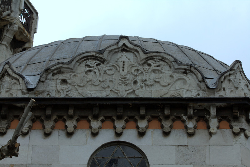 Intricate details on the top of a small Jewish church.