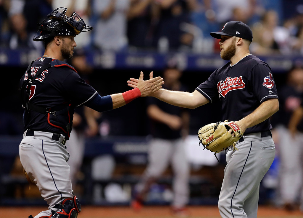 . Cleveland Indians pitcher Cody Allen, right, celebrates with catcher Yan Gomes after Allen closed out the Tampa Bay Rays during the ninth inning of a baseball game, Tuesday, Sept. 11, 2018, in St. Petersburg, Fla. Cleveland won the game 2-0. (AP Photo/Chris O\'Meara)