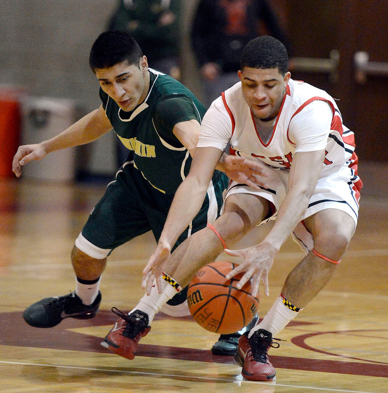 . LITTLETON, CO. - JANUARY 29: Mountain Vista Chandler Wiscombe (2) loses the ball to Regis Josh Perkins (3) at mid court  during their game January 29, 2013 at Regis.  (Photo By John Leyba / The Denver Post)