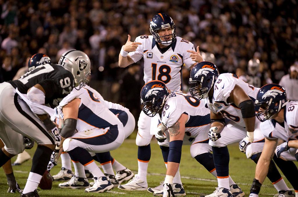 . Denver Broncos quarterback Peyton Manning (18) checks off during the first quarter against the Oakland Raiders  Thursday, December 6, 2012 during Thursday Night Football at O.c Coliseum in Oakland  John Leyba, The Denver Post