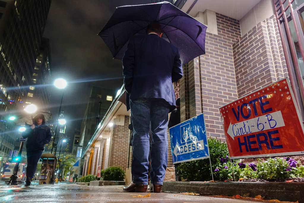 . Voters arrive at a polling station, Tuesday, Nov. 7, 2017, in downtown Cincinnati. Ohio voters will decide ballot issues on Tuesday that would place limits on drug prices and expand victims\' rights in criminal proceedings, along with several mayoral races. (AP Photo/John Minchillo)