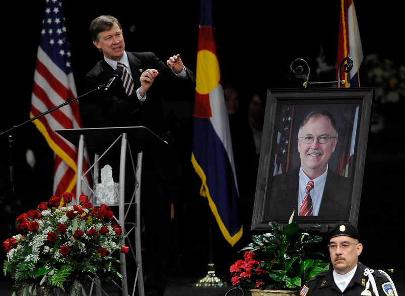 . Colorado Gov. John HIckenlooper speaks about his cabinet member and friend, Tom Clements during a public memorial for the chief executive of the Colorado Department of Corrections at New Life Church in Colorado Springs, Colo., on Monday, March 25, 2013. Corrections officials and guards from as far away as Morocco are among the hundreds of people who turned out Monday to honor Clements, killed March 19 when he answered the door of his home in a wooded, rural area north of Colorado Springs. (AP Photo/The Gazette, Jerilee Bennett, Pool)