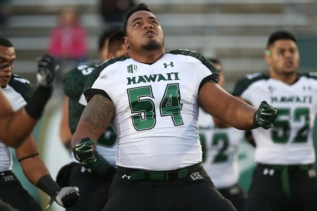 . Hawaii defensive lineman Penitito Faalologo leads teammates in the traditional haka before facing Colorado State in an NCAA college football game in Fort Collins, Colo., on Saturday, Nov. 8, 2014. (AP Photo/David Zalubowski)