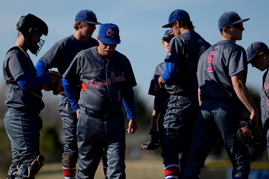 . Aurora, CO - APRIL 08: Head coach Marc Johnson of the Cherry Creek Bruins walks away from a mound visit to Cody Wood (4) during the fourth inning of action. Overland hosted Cherry Creek on Tuesday, April 8, 2014. (Photo by AAron Ontiveroz/The Denver Post)