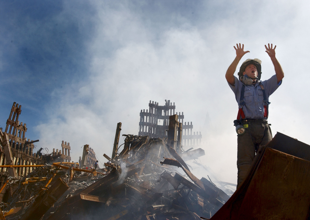 . A New York City fireman calls for 10 more rescue workers to make their way into the rubble of the World Trade Center September 14, 2001 days after the September 11, 2001 terrorist attack. (U.S. Navy Photo by Jim Watson/Getty Images)