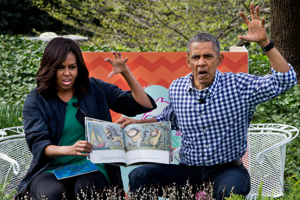 ". President Barack Obama and first lady Michelle Obama make claw hands and monster faces while reading, ""Where The Wild Things Are,\"" during White House Easter Egg Roll at the White House in Washington, Monday, March 28, 2016. Thousands of children gathered at the White House for the annual Easter Egg Roll. This year\'s event features live music, sports courts, cooking stations, storytelling, and Easter egg rolling. (AP Photo/Jacquelyn Martin)"