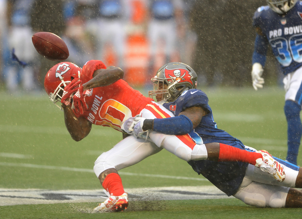 . AFC receiver Tyreek Hill (10), of the Kansas City Chiefs, fumbles the ball as NFC linebacker Kwon Alexander (58), of the Tampa Bay Buccaneers makes the tackle, during the first half of the NFL Pro Bowl football game, Sunday, Jan. 28, 2018, in Orlando, Fla. (AP Photo/Steve Nesius)