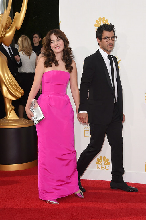 . Actress Zooey Deschanel and producer Jacob Pechenik attend the 66th Annual Primetime Emmy Awards held at Nokia Theatre L.A. Live on August 25, 2014 in Los Angeles, California.  (Photo by Jason Merritt/Getty Images)